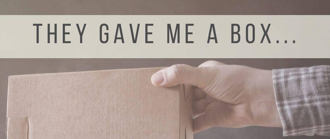 man handing someone a box